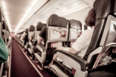 Blurred image of airplane interior in cabin Royalty Free Stock Images