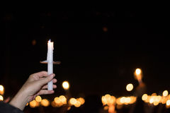 Blurred image for background of hand with candle memorable for King Bhumibol Adulyadej of thailand Stock Image