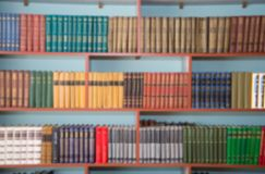 Blurred image of bookshelves in a public library. School library. Education concept