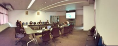 Blurred image of business people and student sitting in conference room, meeting room for profession seminar with screen projector. For present information stock photo
