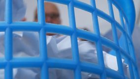 Blurred Image with Businessman in Office Throwing Crumpled Paper on Trash Basket.  stock footage
