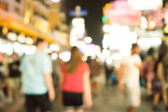 Blurred image of busy night life in the city. Stock Images