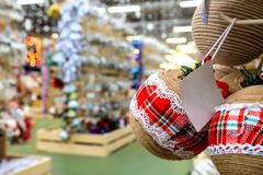 Blurred image of Christmas and New Year decorations in the store, balls, toys and garlands on the shelves, defocused background stock images