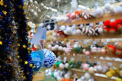 Blurred image of Christmas and New Year decorations in the store, defocused background of the market in winter royalty free stock photos