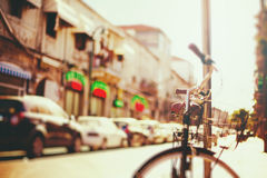 Blurred image of city street with bicycle Royalty Free Stock Images