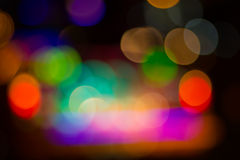 Blurred image of colorful festive lights that can be used as bac Stock Images
