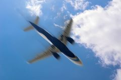 Blurred image of commercial or cargo plane moving fast downwards. Fear of flying. plane in the sky and the motion royalty free stock photography