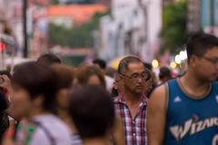 Blurred image of a crowd of people at a street market. Malacca, stock images