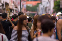Blurred image of a crowd of people at a street market. Malacca, royalty free stock image