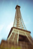 Blurred image of the Eiffel Tower in Paris, France. Selective focus on details. Lensbaby shot of Eiffel Tower, retro, vintage and instagram filters. Best stock images