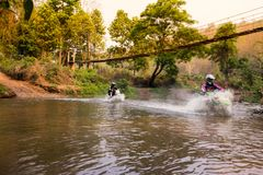 Blurred image enduro motorcycle racer drove into the water. Riding a motorcycle enduro royalty free stock images