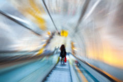 Blurred image of the escalator with a silhouette Stock Photo