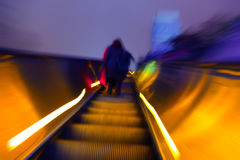 Blurred image of the escalator with a silhouette Royalty Free Stock Photo