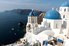Blurred image of the famous 3 Blue Domes at Santorini.  Royalty Free Stock Photography
