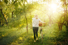 Blurred image of female with bicycle Royalty Free Stock Images