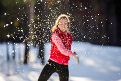Blurred image the girl throws a snowball. Sunny winter day Royalty Free Stock Images