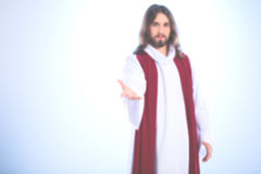 Blurred image of Jesus Christ. Reaching out his hand Royalty Free Stock Photography