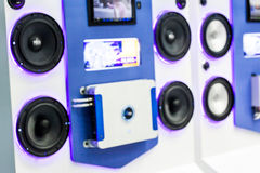 Blurred image of luxury car audio show for sale in shop Stock Photo