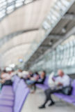 Blurred image of a man read newspaper while waiting the flight i Stock Photos