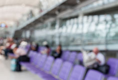 Blurred image of a man read newspaper while waiting the flight i Royalty Free Stock Photo