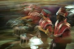 Blurred image of marching high school band. New Orleans, 2007.  Lundi Gras. The Krewe of Orpheus parade.  Marching bands Royalty Free Stock Images