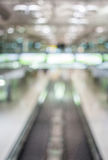 Blurred image of moving modern escalator way in the airport hall Royalty Free Stock Photography