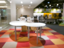 Blurred image of office - ideal for presentation background uses Stock Photography