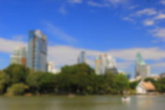 Blurred image of the park in the city during daytime Stock Photo