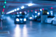 Blurred image Parking garage In the mall for background. Car parking lot in building shopping mall royalty free stock photography