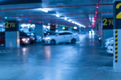 Blurred image parking garage in the mall for background. Car parking lot in building shopping mall royalty free stock images