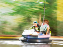Blurred image of people on the electric car. In amusement park royalty free stock photos