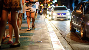 Blurred image of people moving in crowded night city street. Chiang mai , Thailand Royalty Free Stock Photo