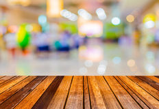 Blurred image of people at trade show. Blurred image of wood table and trade show in shopping mall for background usage royalty free stock images