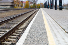 Blurred image of railway track and rail platform Royalty Free Stock Image