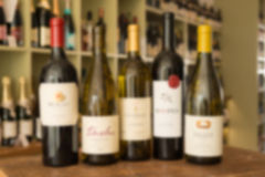 Blurred Image of a Row of Five Wine Bottles Stock Image