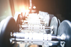 Blurred Image Rows of dumbbells in the gym.