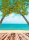 Blurred image of sea sky coconut tree with wooden under Royalty Free Stock Photo
