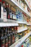 Alcoholic drinks. Blurred image of shelves with alcoholic drinks in supermarket royalty free stock image