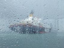 Blurred image of a ship in the rain.
