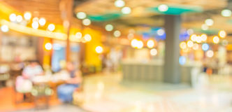 Blurred image of shopping mall and restaurant. Stock Photos