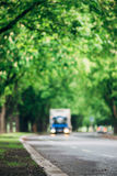 Blurred image of truck driving on asphalt road. Vertical composition Royalty Free Stock Photos