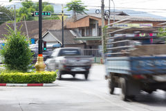 Blurred image of vehicles running on street in Thailand (motion Royalty Free Stock Photo