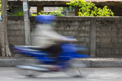 Blurred image of vehicles running on street in Thailand (motion royalty free stock images