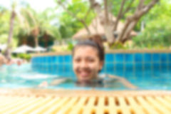 Blurred image of woman in a swimming pool. Stock Photo