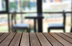 Blurred image wood table and abstract visitor`s chair in office. Royalty Free Stock Image