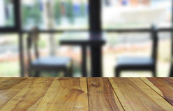 Blurred image wood table and abstract visitor`s chair in office. Stock Image