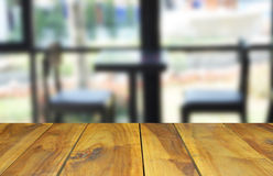 Blurred image wood table and abstract visitor`s chair in office. Stock Photos