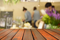 Blurred image wood table and food at night festival with bokeh b Stock Photos