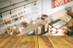 Blurred image  wood table on people in cafe resaturant vintage c. Offee shop Royalty Free Stock Photo