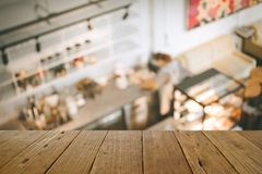 Blurred image  wood table on people in cafe resaturant vintage c. Offee shop Royalty Free Stock Photos